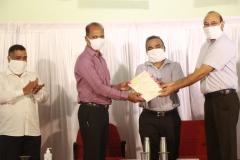 Shri. Sanjith Rodrigues, Commissioner, Corporation of the City of Panaji, receiving outstanding Secretary award